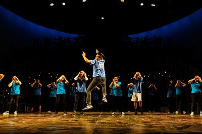 Promotional graphic of students dancing onstage for Pam F...