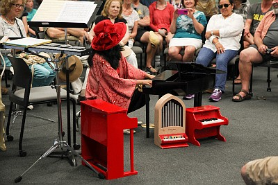 Photo of someone playing a toy piano, courtesy of UCSD Ge...