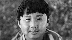 Promotional photo of a young boy in black and white. Courtesy of photographer...