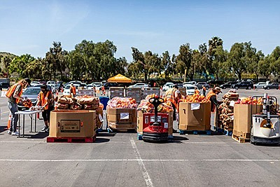 Promotional photo of a food distribution event. Courtesy ...