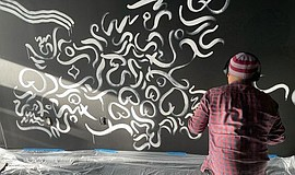 Promotional photograph of artist T.Jay Santa Ana at work ...