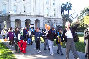 Tease photo for Advocates Rally For Brown To Spare Adult Health Care Program