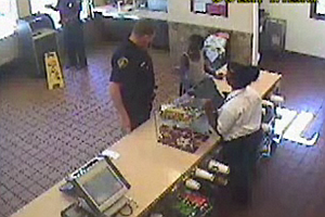 Tease photo for Slain Officer's Gesture To Boy In McDonalds Captures Mourners