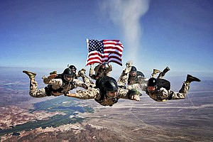 Tease photo for Marine Free Fall Instructors Honor Deceased Marine In Unique Way