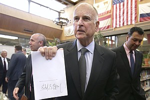 After Wading Through Hundreds Of Bills, Gov. Brown Clears...