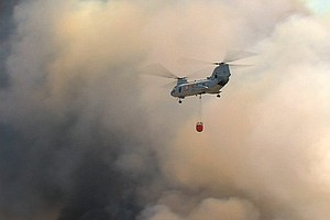 Firefighters Use Air Fleet To Aid Wildfire Ground Battle