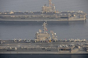 USS Carl Vinson Takes Over Airstrike Campaign From USS Ge...