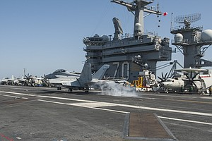 Tease photo for San Diego-Based Troops On USS Carl Vinson Launch Daily Airstrikes Against ISIS