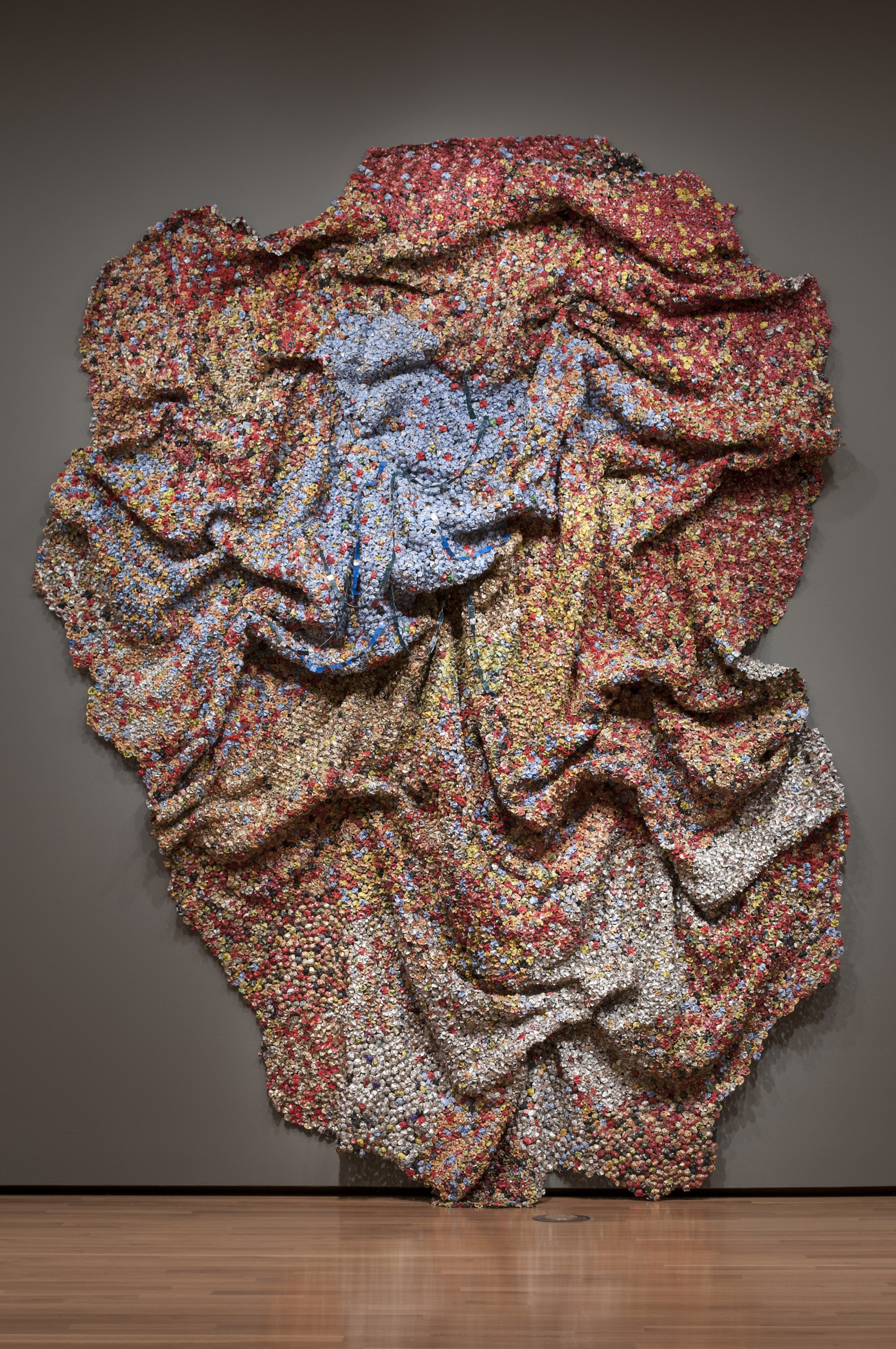 "el anatsui inspired artwork ""gravity and grace: monumental works by el anatsui"" (open through  were  initially inspired by a chance find outside a distillery in nigeria."