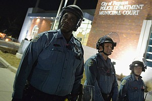 Tease photo for 2 Police Officers Shot Outside Ferguson Police Department