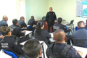 Training Tijuana Cops To Avoid HIV Infections From Needle...