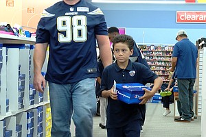 Tease photo for San Diego Chargers Take School Children Shopping For Shoes