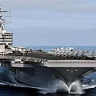 The aircraft carrier USS Ronald Reagan, based in San Diego for 11 years until it departed at the end of last month, Thursday arrived at its new home of Yokosuka, Japan