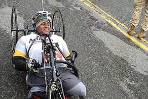 Tease photo for Injured Marine Veteran Rolls To Finish Line At Washington, D.C., Marathon