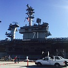 The aircraft carrier USS Theodore Roosevelt was part of a three-way swap of carrier home ports.