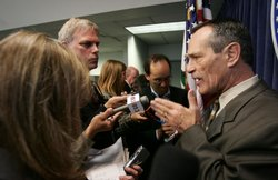 Alan Bersin, speaks to reporters after a press conference.
