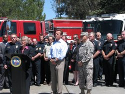 Gov. Schwarzenegger looks on as San Diego County Supervisor Diane Jacob addresses the media about wildfire preparedness.