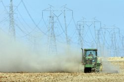 Dust billows as a farmer plows a dry field April 16, 2009 near Buttonwillow, ...