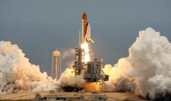 The Space Shuttle Atlantis STS-125 blasts off from launch pad 39-A at Kennedy...
