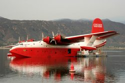 A Super Scooper firefighting plane fills up in Lake Elsinore.