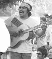 "Ramon ""Chunky"" Sanchez singing ""huelga"" (strike) songs supporting the United Farm Workers grape strike c.1972."