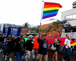Joey Fernando of Mission Hills waves a rainbow flag during the march.