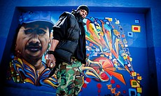 Culture Shock dancer, Sherman Shoate in front of Crol vs Werc mural.