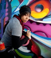 Culture Shock San Diego dancer, Angela Molton in front of Mr. Maxx Moses' (AKA Pose2) wall mural on 9th and G street