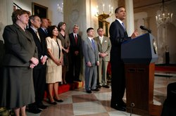 President Barack Obama (R), surrounded by administration officials, speaks about the Chapter 11 bankruptcy filing by General Motors June 1, 2009 from the White House in Washington, DC. GM's bankruptcy filing is the fourth largest in American history and the U.S. government will hold a 60 percent interest in the reorganized company.