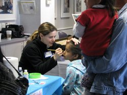 Dr. Daniela Carvalho took time to help out with the face painting at a weekend party for kids who've received cochlear implants at Rady Children's Hospital in San Diego.