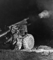 """The Jazz Singer"" African-American soldier yells to protect his eardrums as he shoots off a 105 mm howitzer.  Photo taken by U.S. Army staff photographer during the Korean War.  From the photo collection of William Orcutt."