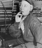 "Actress Betty Hutton sits at a switchboard posing on a visit to Korea with the USO during the Korean War.  Caption written by William Orcutt: ""Betty Hutton operates 4th Signal switchboard (before I came here)"""