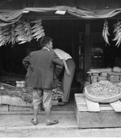 Korean merchant shop selling dried fish and seaweed.  Taken in Seoul during the Korean War.