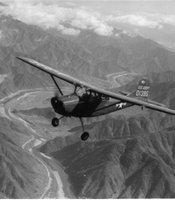 "U.S. Army Signal Corps plane.  Caption written by William Orcutt, ""Over the hills of Korea with Lt. Hurst & 4th Signal Bu plane (that's me in the back seat [William Orcutt]) June 1952"""