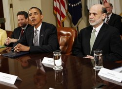 U.S. President Barack Obama (C) meets with regulators and U.S. Secretary of the Treasury, Timothy Geithner (L) and U.S. Federal Reserve Chairman Ben Bernanke in the Roosevelt Room of the White House, June 17, 2009 in Washington, DC. Obama unveiled new sweeping financial regulations in response to the economic crisis.