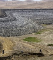 The rocks surrounding this dry section of the San Luis Reservoir, show the where the water line used to be. The water supply is down more than 185 feet from normal levels. (Photo by David Paul Morris/Getty Images)