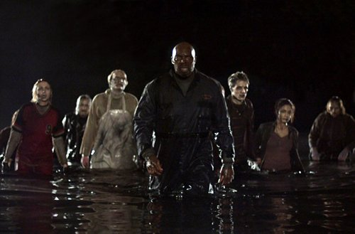 "In ""Land of the Dead"" Romero pokes fun at the Bush administration as zombies attack an elite high rise"