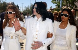 Michael Jackson with sisters LaToya Jackson (L) and Janet Jackson exit the Sa...