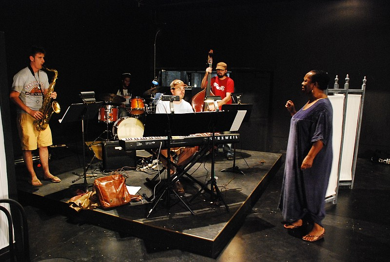 Candace Ludlow Trotter works with the band during rehearsal.  She plays Dinah Washington in this production of Jazz Queens Cast Blue Shadows.