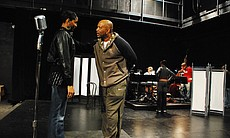 Director Hassan El-Amin works with actress Chondra Profit during rehearsal.