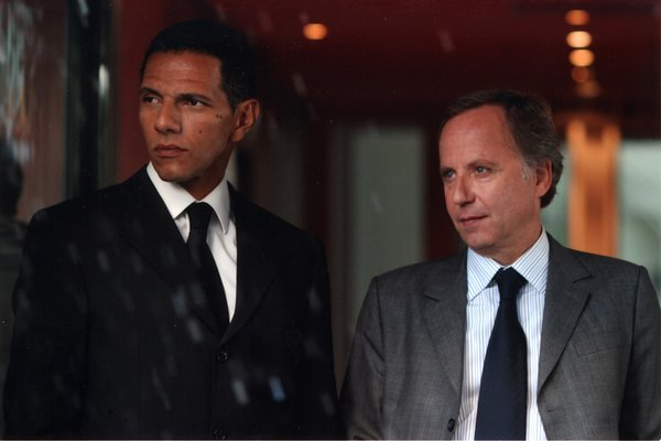 "The bodyguard and his client in ""The Girl From Monaco"""
