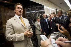 California Governor Arnold Schwarzenegger speaks to reporters outside his off...