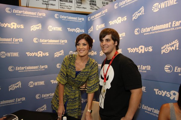 "Jennifer Carpenter of ""Dexter"" with a fan at the Entertainment Earth booth signing autographs."