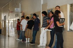 Chula Vista High School students wait in line to register on the first day of...