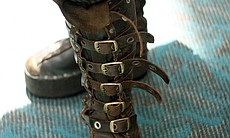 Detail of the elaborate boots worn by a gentleman steampunk.