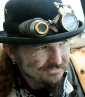 "Nick Baumann is one of the founding members of the Steampunk Ghostbusters.  Period goggles, like Nick's, are a key accessory to steampunk fashion.  Though during the meetup, it was noted that steampunks shouldn't be ""goggle nazis.""  If someone wants to start dressing in the steampunk style, they don't necessarily need goggles."