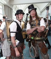 Steampunks waiting to get into the meetup at Comic-Con. You can see the gadgetry featured in their costumes.