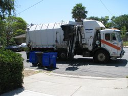 A union operated San Diego garbage truck makes its rounds. City employee unions are balking at a new pension reform the would freeze employee pay in an effort to lower pension costs.