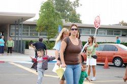 Parents drop-off their children at Cook Elementary in Chula Vista on the firs...