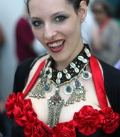 Though the color scheme of steampunk attire tends to be browns and blacks, a splash of red is often used as an accent.